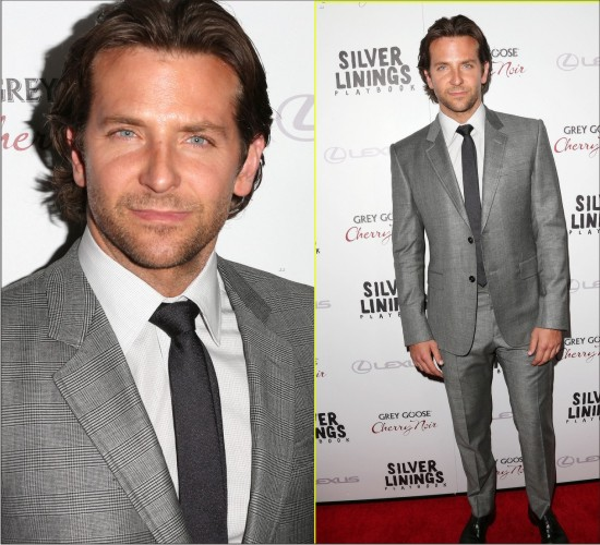 HOT BARDLEY COOPER IN FASHION WEARING A SILVER SUIT ON THE RED CARPET.