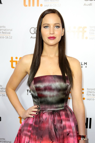 JENNIFER LAWRENCE WEARING A FANCY COLORFUL DRESS AT A PREMIER FOR THEIR MOVIE ONCE AGAIN.