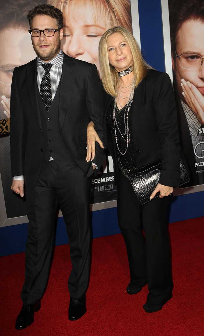 "SETH ROGEN AND BARBARA STREISAND ARM AND ARM AT THE RED CARPET EVENT FOR THEIR MOVIE ""THE GULIT TRIP""."