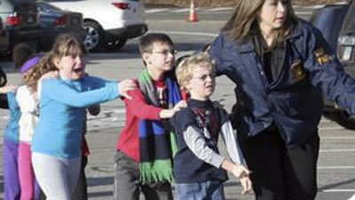 Scared children wait single file earlier today.