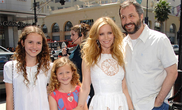 GROUP SHOT OF APATOW FAMILY ALL WEARING WHITE EXPECT FOR IRIS APATOW WHIO STANDS OUT.