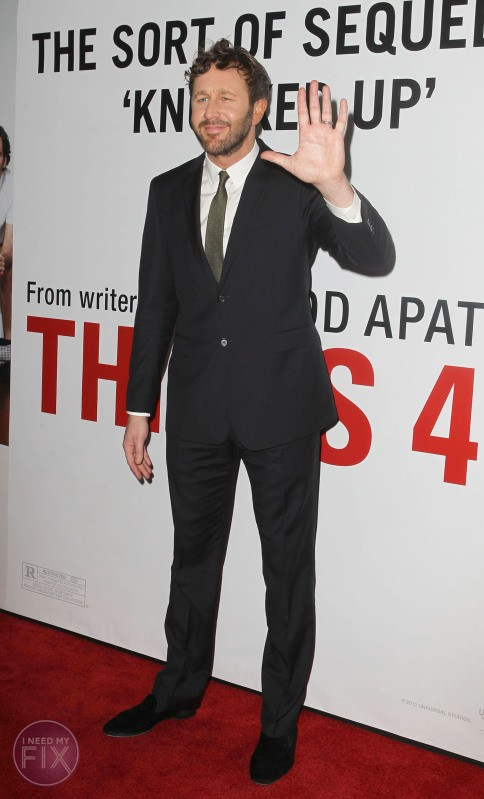 """FULLY BODY - CHRIS O'DOWD STANDING IN FRONT OF THE """"THIS IS 40"""" MOVIE POSTER SMILING AND WAVING TO HIS FANS."""