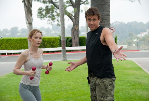 SCENE IN THE BEGINNING OF MOVIE - ACTOR JASON SEGEL GIVING ACTRESS LESLIE MANN A FITNESS LESSON.