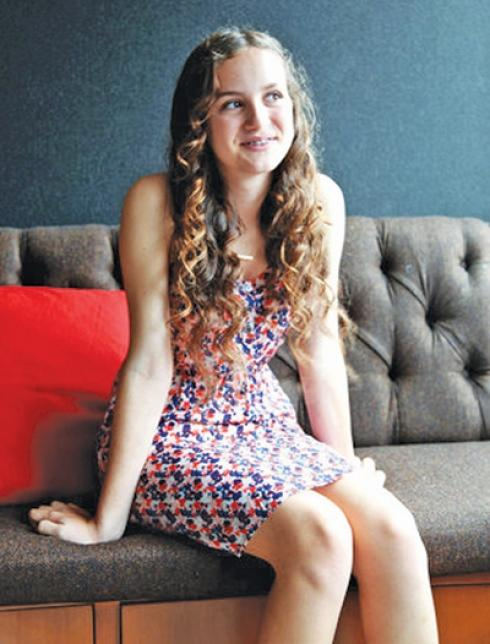 NICE SHOT OF MAUDIE APATOW SITTING ON COUCH THINKING.