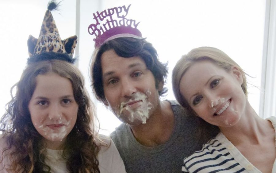 CAST -  (LEFT TO RIGHT IN ORDER) MAUDE APATOW (OLDEST DAUGHTER), PAUL RUDD (FATHER), LESILE MANN (MOTHER) EATING MESSY BIRTHDAY CAKE THAT GOT ALL OVER THEIR FACES.  HOW ADORABLE.
