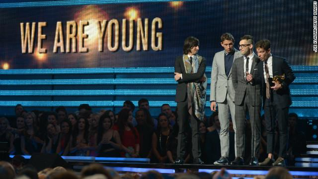 ON STAGE ACCEPTING THEIR AWARD AT THE 2013 GRAMMY'S.