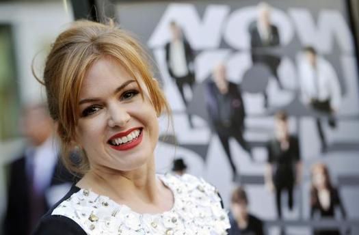 "ACTREE - ISLA FISHER STANDING IN FRONT OF THE ""NOW YOU SEE ME"" MOVIE POSTER."