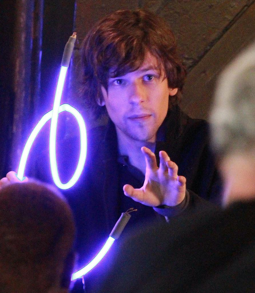 ACTOR -  JESSIE EISENBERG DOING A LIGHT TRICK IN THE MAGIC SHOW. HOW GROOVY !!