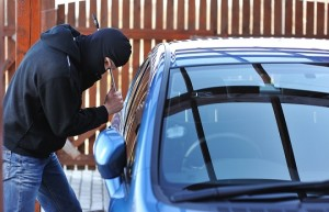 masked-man-breaking-into-car