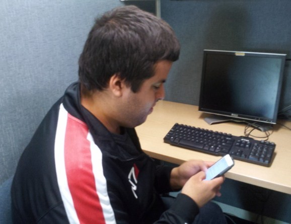Student, Roberto Heriquez finds jobs through social media on his phone.