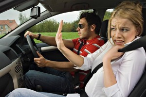 He is driving, she is anxious