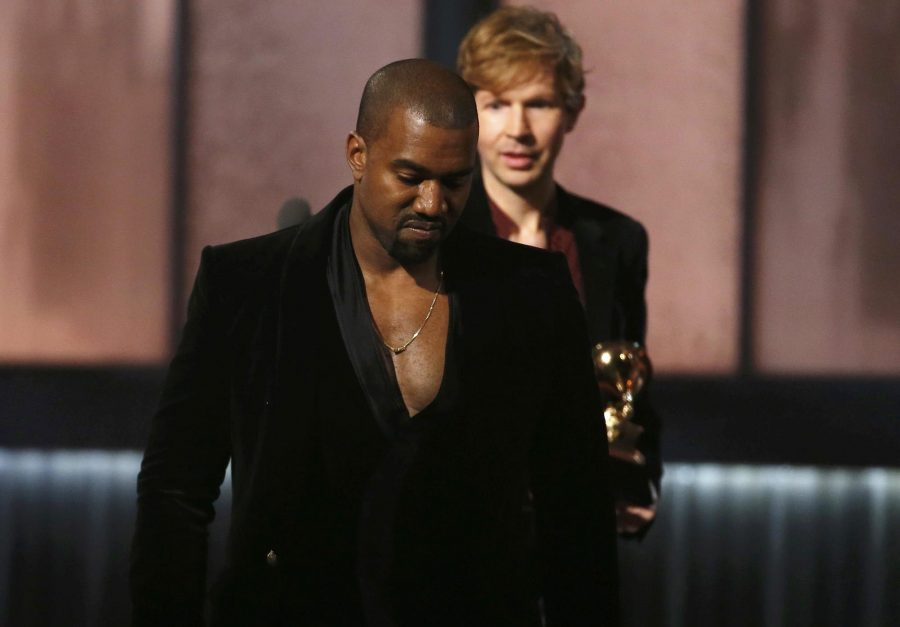 Beck watches Kanye West after Beck won album of the year for