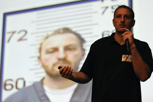NORTHGLENN, CO: Sept 25, 2013  Ethan Fisher, of LifeCONsequences, speaks in front of students at Northglenn High School in Northglenn on Wednesday, Sept. 25. Fisher, a star athlete in high school and college, abused drugs and alcohol when he was young and was convicted of vehicular manslaughter while driving drunk.   (Photo By Erin Hull/The Denver Post)