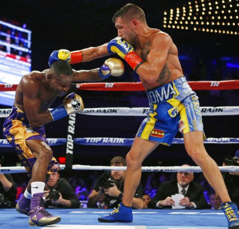 Vasyl Lomachenko, right, of Ukraine, tries to hit Guillermo Rigondeaux with a right during the sixth round of a WBO junior lightweight title boxing match Saturday, Dec. 9, 2017, in New York. Lomachenko won the bout. (AP Photo/Adam Hunger)