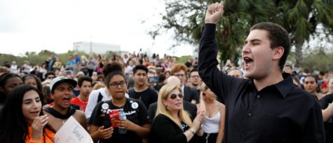 Student Alex Wind from Marjory Stoneman Douglas High School speaks to the crowd during a protest, following a mass shooting in Parkland, Florida, U.S., February 20, 2018. REUTERS/Carlos Garcia Rawlins - RC16D1A24280