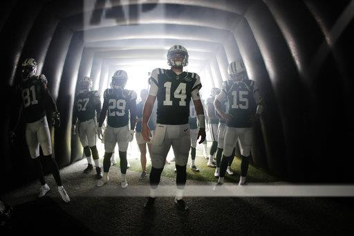 New York Jets quarterback Sam Darnold (14) waits with teammates before an NFL football game against the Miami Dolphins Sunday, Sept. 16, 2018, in East Rutherford, N.J. (AP Photo/Julio Cortez)