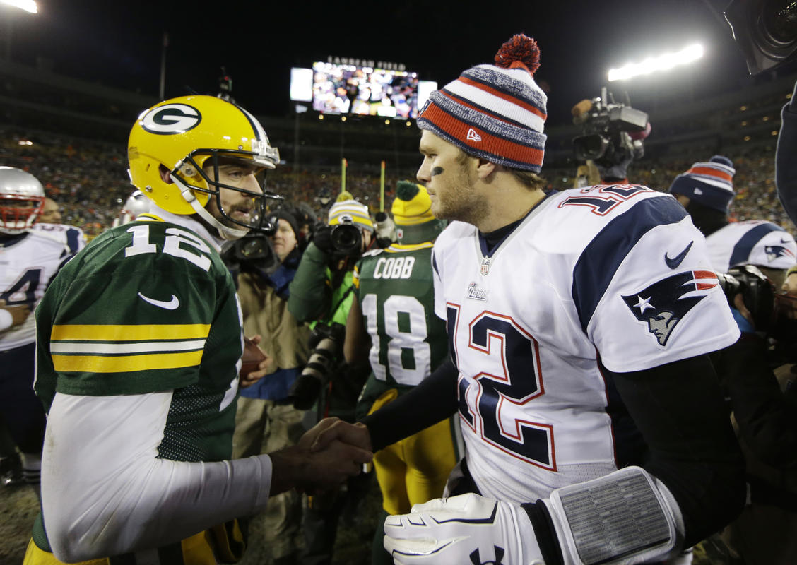Green Bay Packers' Aaron Rodgers shakes hands with New England Patriots' Tom Brady after an NFL football game Sunday, Nov. 30, 2014, in Green Bay, Wis. The Packers won 26-21. (AP Photo/Tom Lynn)