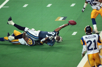 ATLANTA - JANUARY 30:  Kevin Dyson #87 of the Tennessee Titans reaches for the end zone with the ball as Mike Jones #52 of the St. Louis Rams tackles him on the last play of the game during the Super Bowl XXXIV Game at the Georgia Dome on January 30, 2000 in Atlanta, Georgia. The Rams defeated the Titans 23-16. (Photo by: Tom Hauck /Getty Images)